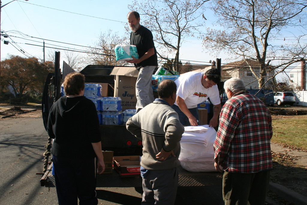 Five Towns Community Center Director Peter Visconti and Center counselor Felipe Plaza handed out food, water and supplies to residents on Cheshire Road and the surrounding streets in Inwood on Monday afternoon.