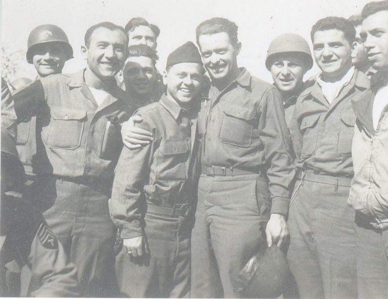 Cpl. John D. Summerville with his arm around movie star Mickey Rooney after Rooney had entertained U.S. troops in Germany.