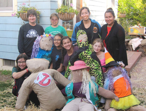 these Scarecrows stuffers, clockwise from top left, are Nancy Houser, Grace Houser, Maria Fernandez, Paula Reyna, Shannon Dempsey, Alia Reyna, Jaida Fernandez and Emma Waney.