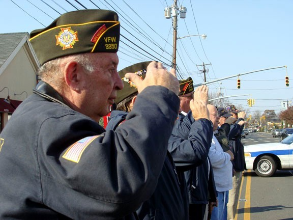 VFW member and Korean War veteran Joel Blaustein saluted the flag.