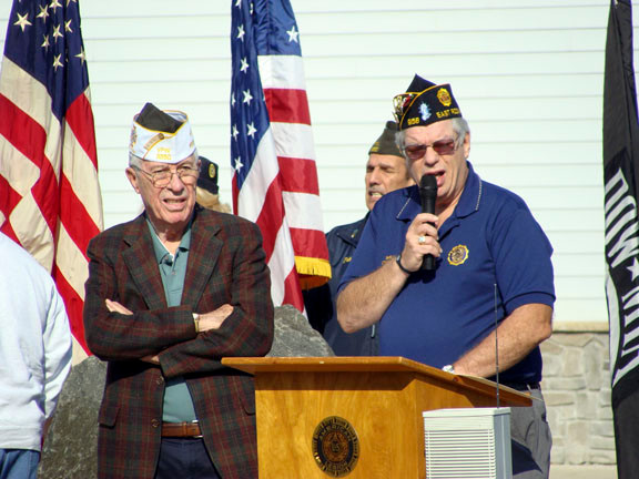 Veteran commanders Joe McCarthy, left, of the VFW, and Shelly Conn, right, of the American Legion, spoke to the crowd.