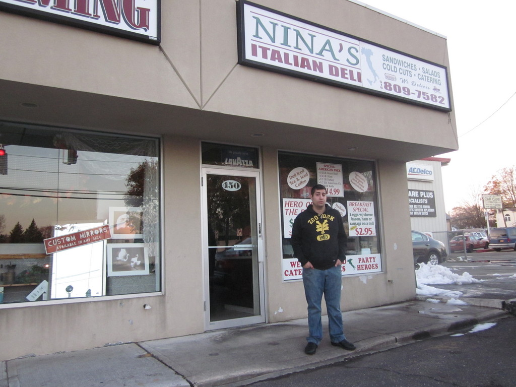 Benny Diasparra, 26, the owner of Nina's Italian Deli, stood outside his powerless shop on Newbridge Road.
