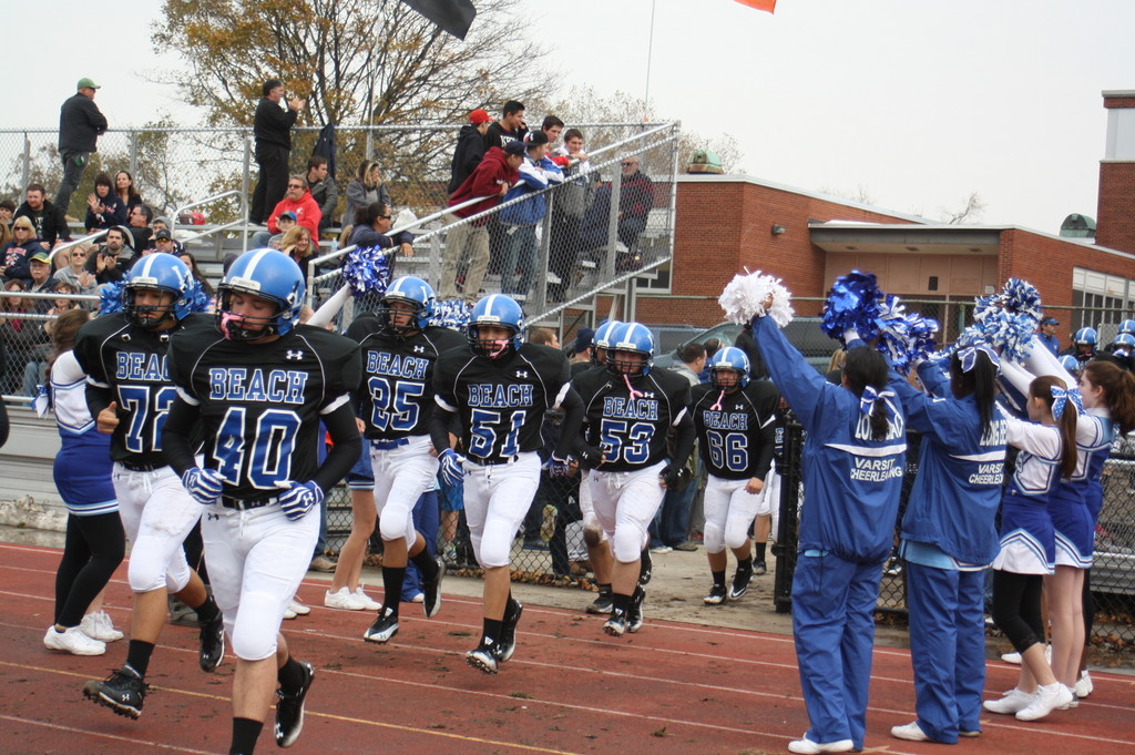 The Long Beach varsity cheerleaders gave the Marines a jubilant welcome as they took the field to face the Carey Seahawks in the Nassau County quarterfinals.