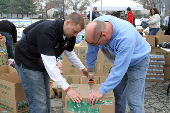 Matt Buck, left, and Tom Mayor prepared boxes for the helicopters' supply drops. The event was hosted by Rock Out Cures, or ROC