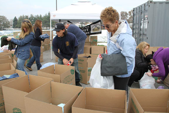 Volunteers like Phyliss Gangone, right, sorted through donations.