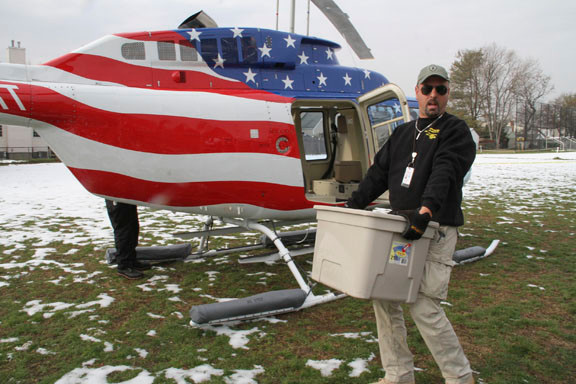 Mike Scillaba donated the use of his two helicopters to transport supplies directly to hard hit areas like Breezy Point.