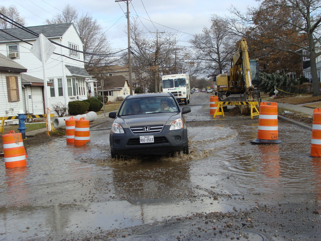 A car drove through partial treated sewage on Rhame Avenue.