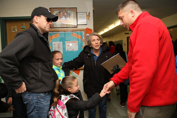 Lincoln Orens Principal John Barnes, right, introduced himself to Hegarty students and their families as they arrived at his school for classes.