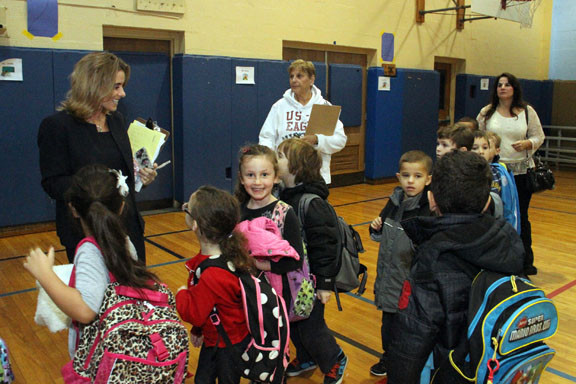 School 8 Principal Laurie Storch joked with students as they headed to their new classrooms.
