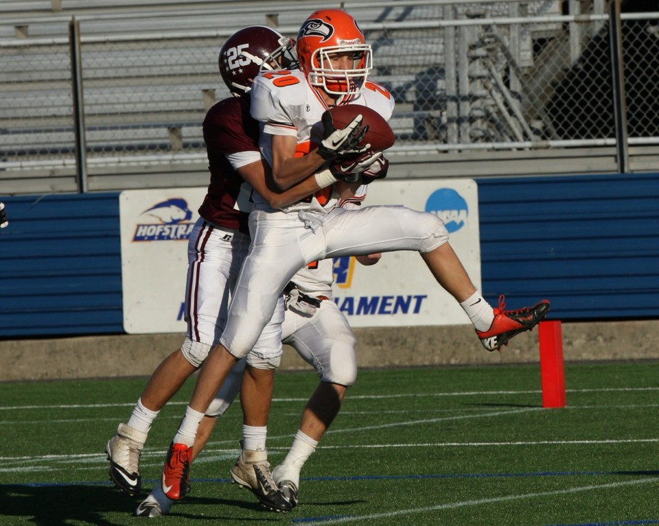 Carey's Dylan DeMeo hauls down some of quarterback Ray Catapano's 353 yards through the air.