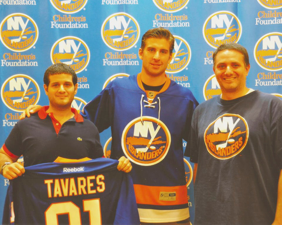Phillip Ferro, left, and his brother William, right, met Islanders all-star center John Tavares over the summer at a season ticket holder event.