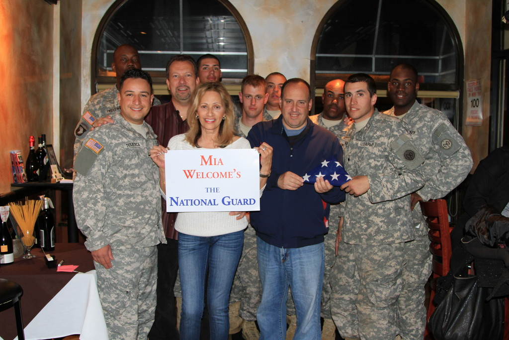 After seeing the hard work of the National Guard following Hurricane Sandy, Cashmere Rios, owner of Mia�s Restaurant, invited 100 National Guard members over for a free meal. Pictured with Rios were Mayor Ed Fare, third from left, Village Clerk Bob Barra, holding flag, and members of the National Guard.