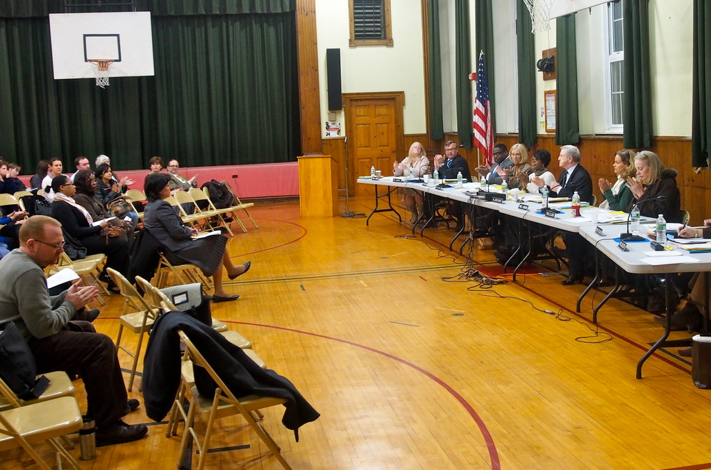 A round of applause accompanied the passage of a motion to allow the East Rockaway school district to lease Baldwin's unused school buildings.