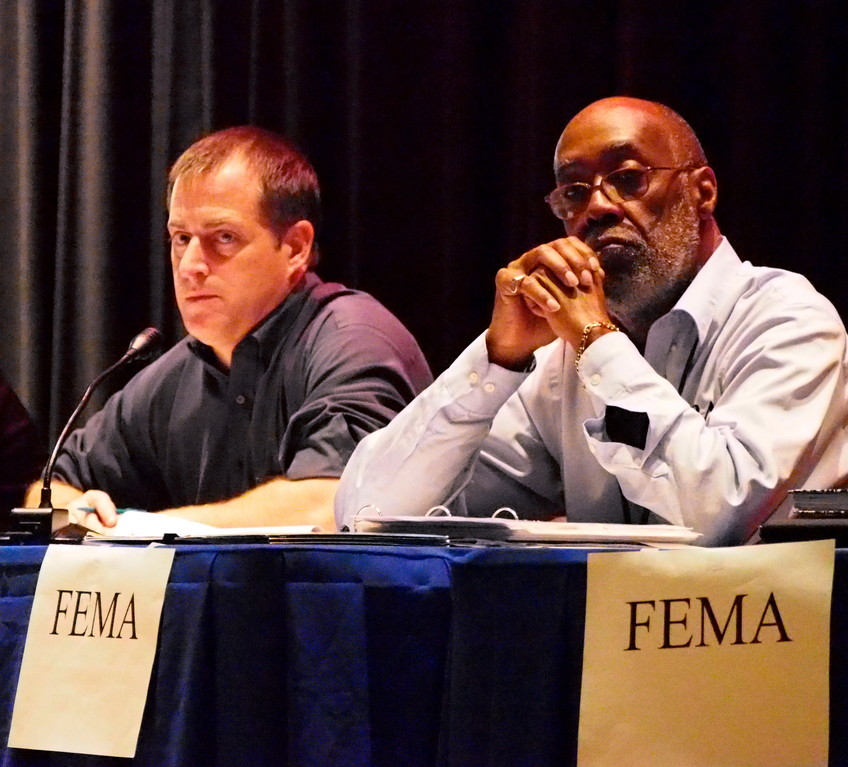CUrran, left, was joined by Gary Dawson, an expert from FEMA, as well as reps from Sani2, the NCPD, a claims specialist, and Legislator Joe Scannell.
