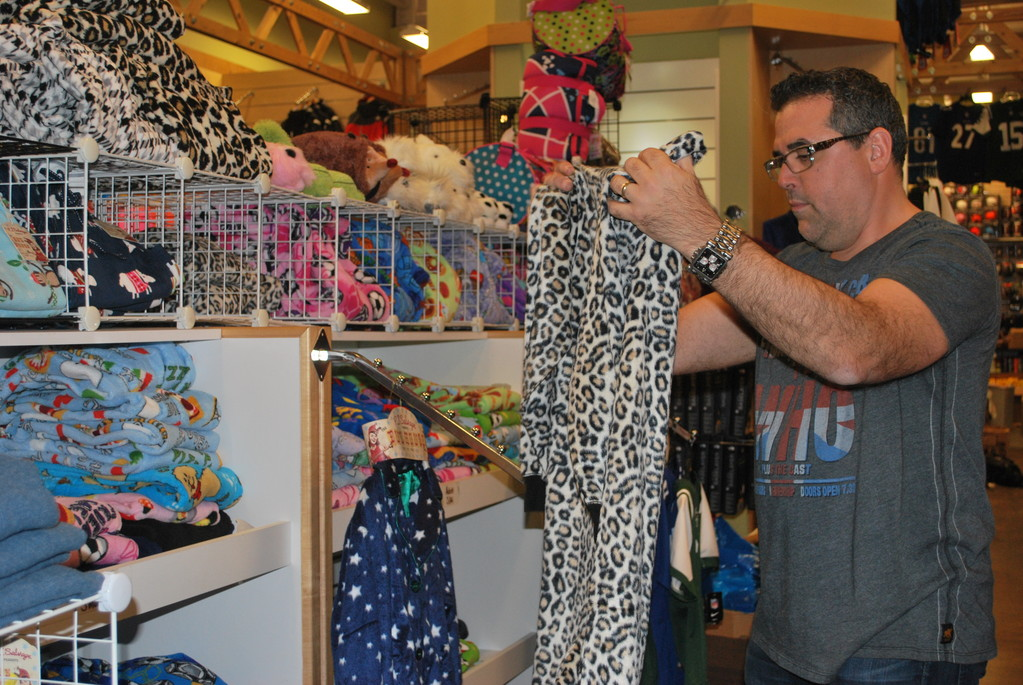 Steve Silverman, the owner of Morton's, a sporting goods and clothing store in Cedarhurst, folded pajamas as he prepared for the madness of holiday shopping.