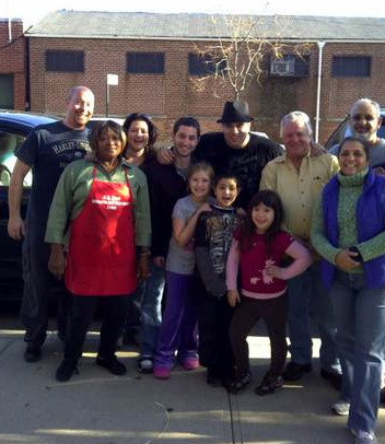 Volunteers who help Nick Paxinox with his Thanksgiving Tradition of feeding holiday meals to those in need.