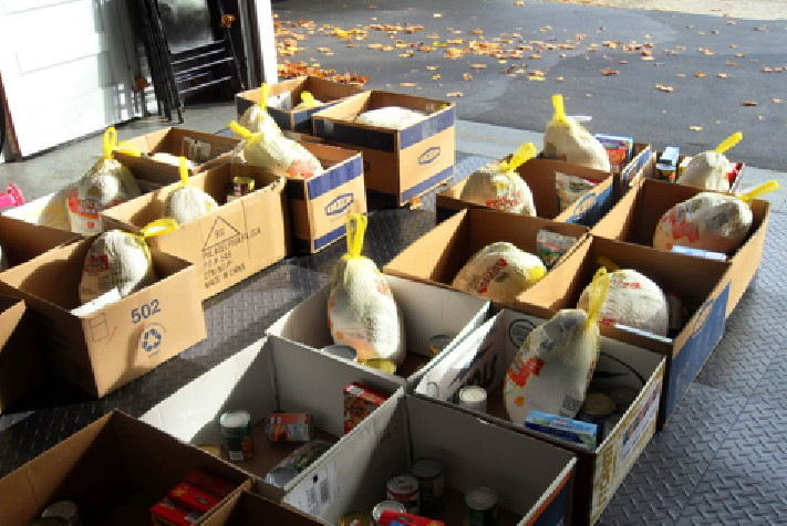 Thanksgiving Tradition volunteers donated 200 turkey dinners to the First Baptist Church in Far Rockaway.