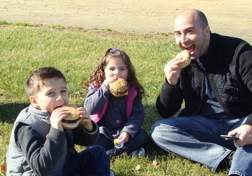 Anthony, 5, Vanessa, 3 and Dan Landolphi of East Rockaway, enjoyed some hot, juicy burgers.