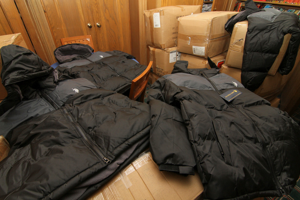 Brand new Polo jackets, in and out of boxes, were ready for donation.
