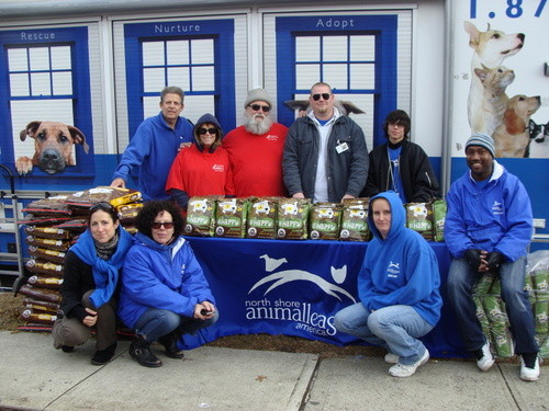 Visiting East rockaway with its mobile unit and pet food, courtesy of Purina PetCare, were, from back row left, Manager of Pet Behavior/Rescue and East Rockaway resident Mike Malloy, NSALA volunteers Marion and Ben Savio, John Gilday, NSALA adoption services, Carlos Correira, a Mercy First student; In front, from left, were NSALA�s Elizabeth Weaver, Mutt-i-gree Outreach Manager Jayne Vitale, Rescue Associate Jen Lewis, and Director of Corporate and National Shelter Outreach Byron Logan.