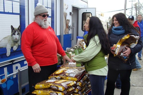 NSALA Volunteer Ben Savio talked with a local pet owner.
