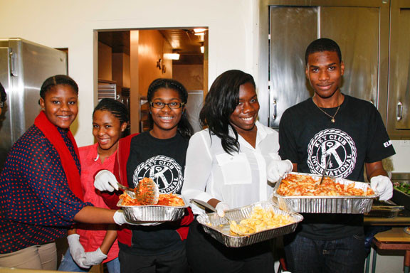 Elmont High School Key Club members, from left, Stephanie Derisma, Alanis Smith, Rhuby Toussaint, Shekina Rousseau and Loick St. Louis were among those who served food at a pasta dinner held for Hurricane Sandy victims on Nov. 13.
