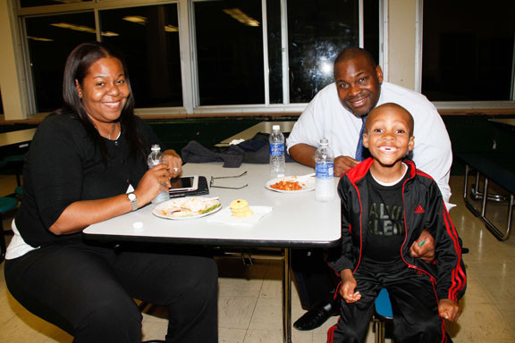 Victoria Thomas, left, and Assistant Principal Edward Thomas enjoyed dinner with their six-year-old son Christian.
