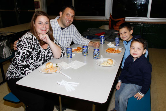 Stephanie Lunati, left, and Joseph Lunati, with sons Jake and Ethan.