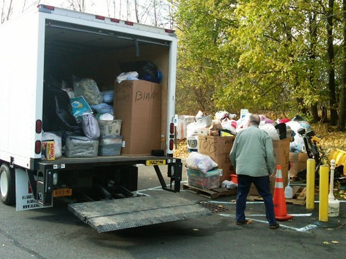 The truck bound for East Rockaway being loaded in Albany by Ted and Becky Hans.
