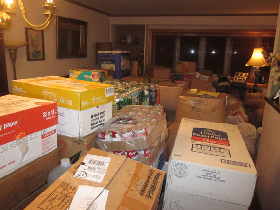 Dozens of boxes in the Ingers' East Meadow home last Friday.