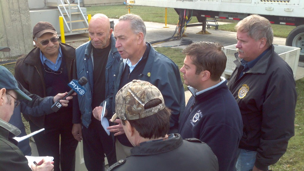 U.S. Sen. Chuck Schumer, pictured at a press conference in Long Beach shortly after Hurricane Sandy, is calling on the Army Corps of Engineers to expedite federally approved plans to protect the barrier island and other coastal areas.