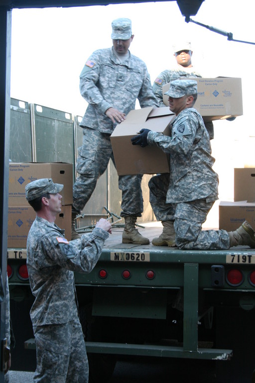 National Guardsmen unloaded the turkeys and individual meals that were given to Five Towns residents.
