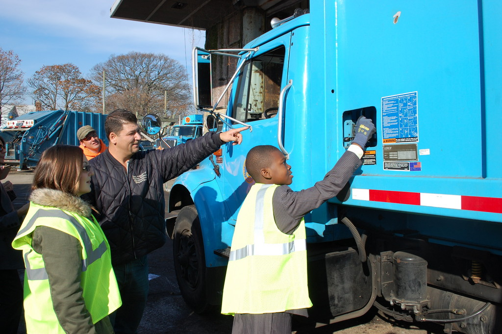 The honorary mayors got to operate the controls of a village garbage truck under the direction of Sanitation Supervisor Wayne Mastrangelo.