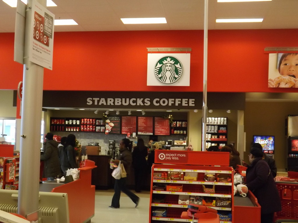 The remodeled Target now has a Starbucks coffee shop near the checkout counters, making many customers happy.