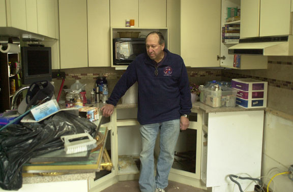 Ralph Isaacs, a retired Lawrence Middle School teacher, said that he plans to remain in Long Beach after Hurricane Sandy ravaged his one-story home, which is halfway between the Long Beach Medical Center and the city's boardwalk. Above, Isaacs in his kitchen nearly three weeks after the storm struck.