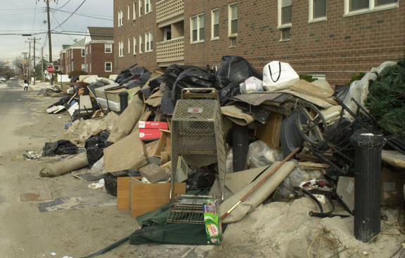 Water-logged rugs were piled high throughout the Isaacses' normally quiet neighborhood.