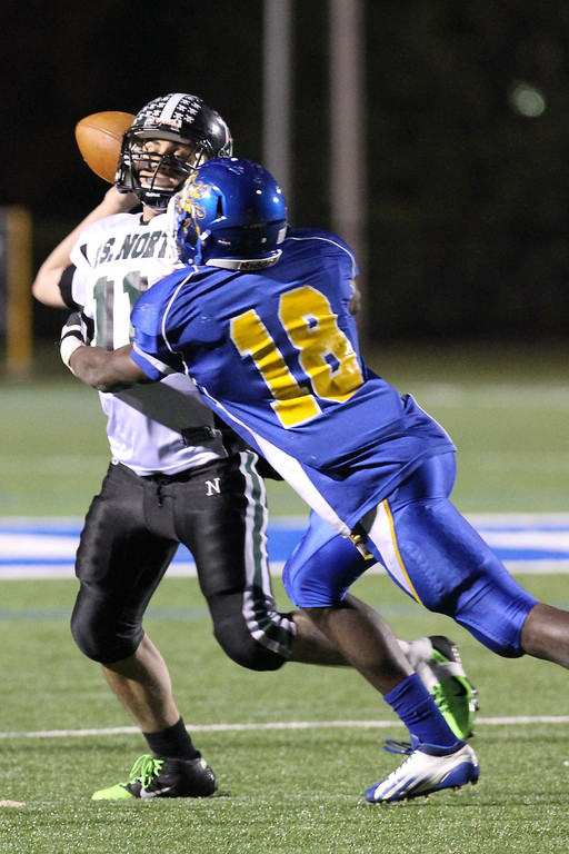 Spartans quarterback Anthony Martelli couldn't avoid the pressure of Roosevelt's Raymond Jones during last Sunday's Conference IV title game.