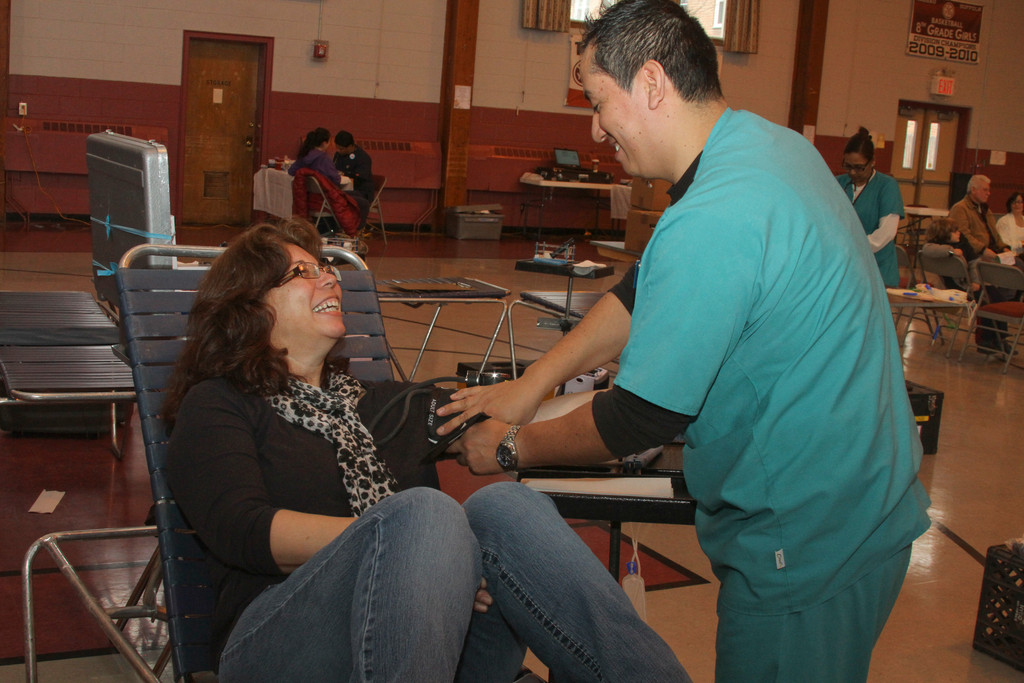 Lucy Negrino is prepped for her blood donation by Mario Paredes.