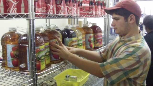 Garrick S. stocked the shelves of a food pantry.