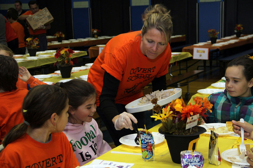 Christine Flatley serves up Thanksgiving lunch at the Covert School.