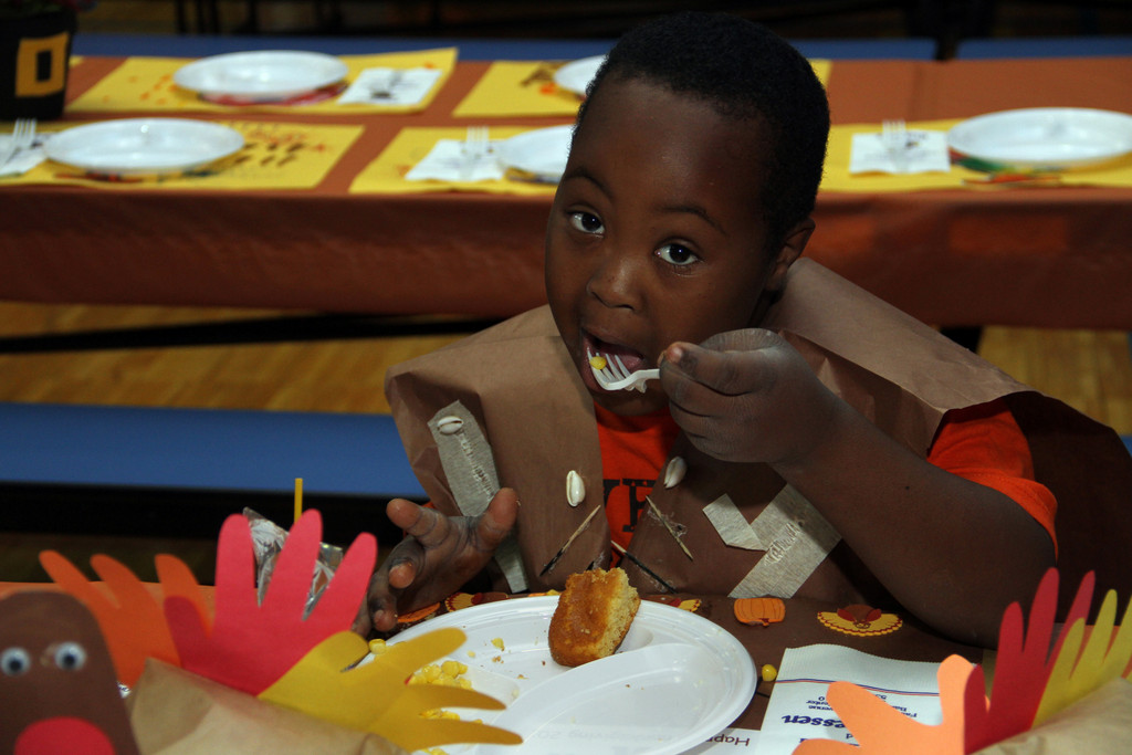 Tyreese Williams enjoys the Thanksgiving feast at Covert School.
