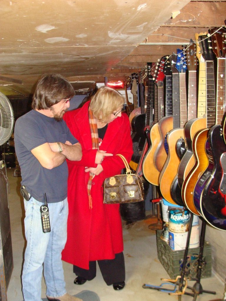 East Rockaway Music store owner Paul Lanzetta showed Chamber President Debbie Hirschberg the mold damage on some of his  guitars that were stored in the basement.