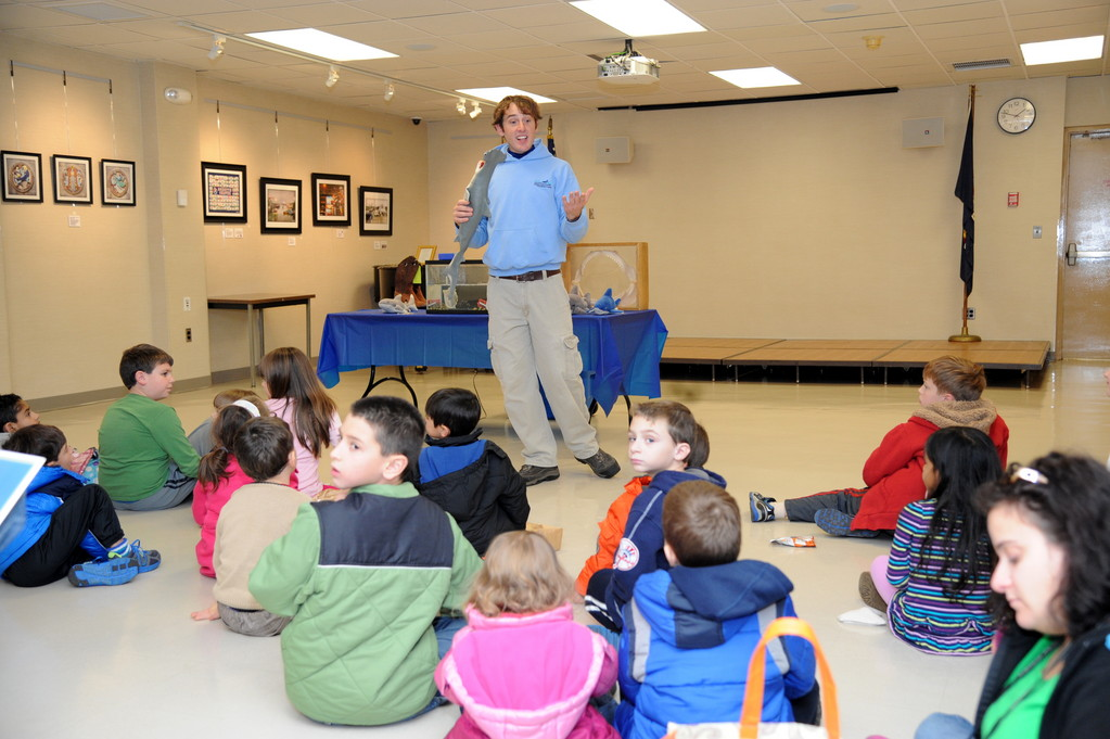 Chris Brady, from the Long Island Aquarium in Riverhead, spoke to kids about sharks during the opening day of the East Meadow Public Library�s Discover Earth exhibit. Brady brought live chain catsharks for the children to observe.