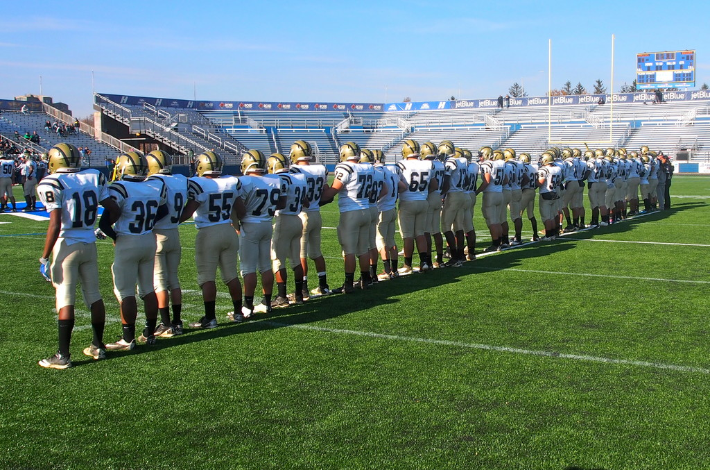 As the Bruins stood together on Friday, they stood for Baldwin � a town that needed something to cheer for.