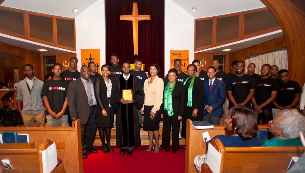 The Memorial Presbyterian Church of Roosevelt was honored for its support of The W.A.N.T.E.D. Project. From left are Minister Philip Jones, The Rev. Kymberly Clemons-Jones, The Rev. Patrick L. Daymond and three elders from Memorial Presbyterian Church and Nassau Legislator Carrie Solages, all joined by members of the W.A.N.T.E.D. Project.