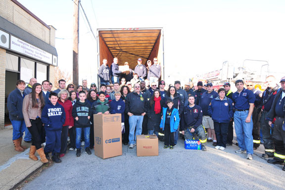 Volunteers from Oceanside and Roosevelt with the firemen and truck from Broome County that came packed with donations from upstate New York.