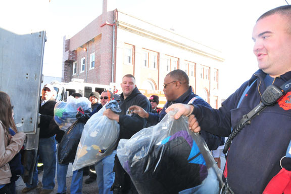 A Human chain was formed to move donated items from the truck inside.