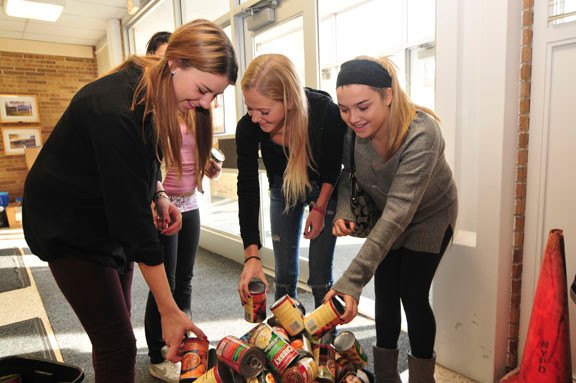 Kaitlyn McHale, Kellie Manning and Victoria Jervis worked together to sort out canned goods.