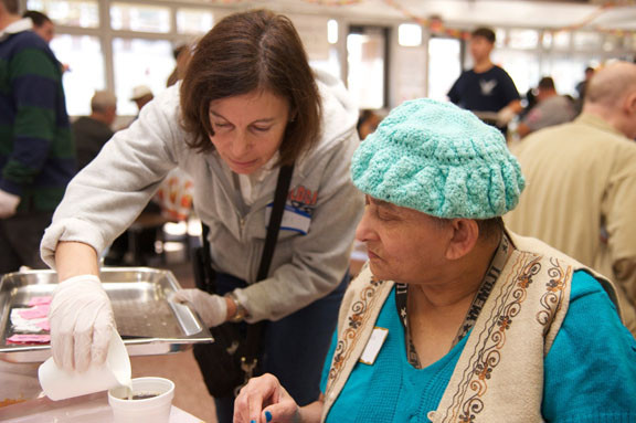 Volunteer Teri Marani and Chitra Mukher at the Thanksgiving dinner held at the Oceanside High School cafeteria.