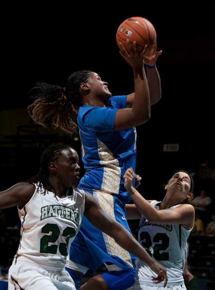 Shante Evans, center, is expected to become the Pride's all-time leader in points and rebounds, and could be a high pick in the WNBA Draft.